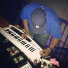 Signing a fan's keytar in Houston (Sept. 2013)